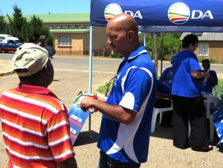 Councillor Eugene Groep at the info table