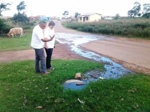 Cllr Fred Campher and MP Elza Van Lingen at one of the many sewage spills in the Kouga.